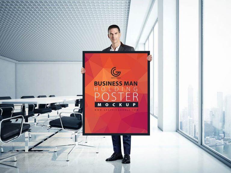 Businessman holding Poster Mockup